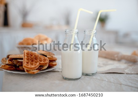 Homemade breakfast: Viennese waffles and milk, cozy picture