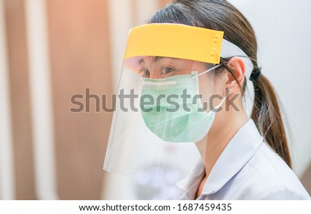 Medical staff wearing face shield and medical mask for protect coronavirus covid-19 virus in CT scan room, protective Epidemic virus outbreak concept Royalty-Free Stock Photo #1687459435