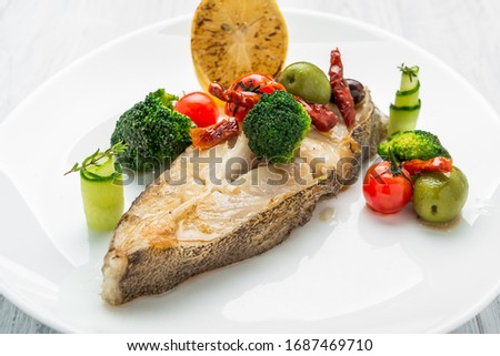 Fried halibut with vegetables and mustard
