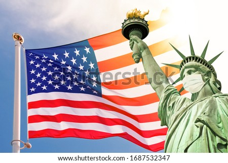 Statue of Liberty wearing a surgical mask, US  american flag background. New coronavirus, covid-19 in New York and USA epidemic crisis concept Royalty-Free Stock Photo #1687532347