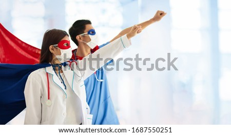 Asian doctor or nurse wearing surgical face mask in superhero cape. Medical staff during coronavirus outbreak in Asia. Super hero power for clinic and hospital personal. #1687550251