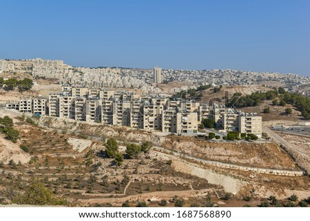 View of a Jewish Settlement on a hill in the West Bank near Bethlehem, Palestine territory. Royalty-Free Stock Photo #1687568890