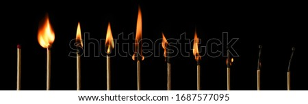 The stages of match burning on a black background. Safe match with red head. Different stages of matchstick burning. From Ignition to decay. Copy space, banner.  Royalty-Free Stock Photo #1687577095