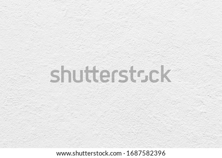 White concrete wall grunge background, cement construction material texture backdrop. Royalty-Free Stock Photo #1687582396