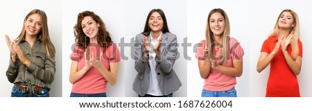 Set of young women over white background applauding after presentation in a conference Royalty-Free Stock Photo #1687626004