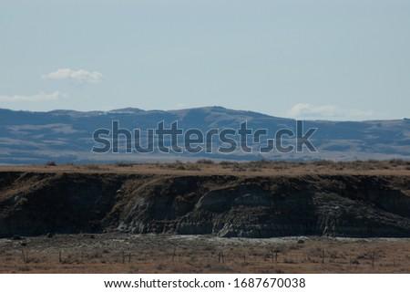 Vista of dry clay and rock badlands #1687670038