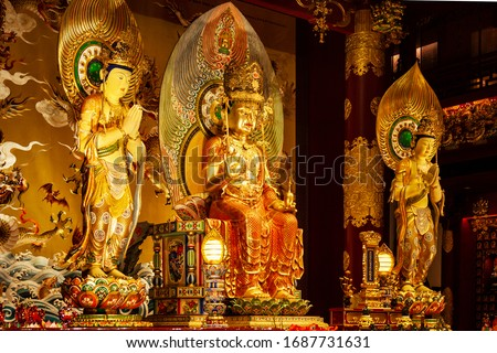 Close-up on the golden statues of the altar inside the Buddha Tooth Relic Temple in Chinatown District Singapore. #1687731631