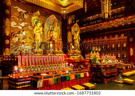 Large altar inside the Buddha Tooth Relic Temple in Chinatown District Singapore. #1687731802