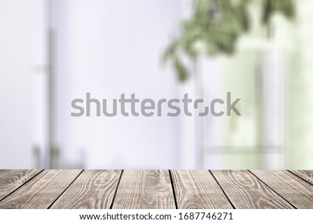 The empty wooden table top on the blur room background #1687746271