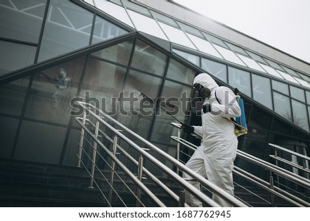 Cleaning and Disinfection at town complex amid the coronavirus epidemic Professional teams for disinfection efforts Infection prevention and control of epidemic Protective suit and mask. #1687762945