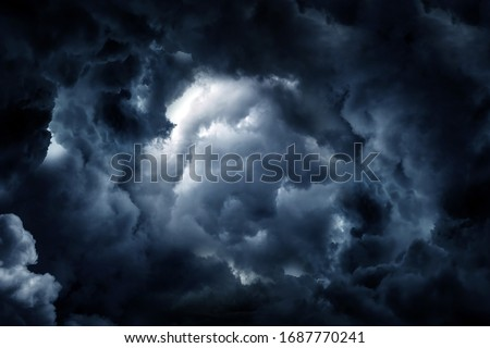 Hole in the Dark and Dramatic Storm Clouds Royalty-Free Stock Photo #1687770241