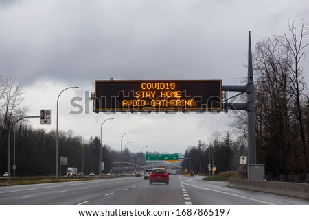 Surrey, Vancouver, British Columbia, Canada. Coronavirus Sign and message to Stay Home on a Trans-Canada Highway. Covid-19 pandemic outbreak