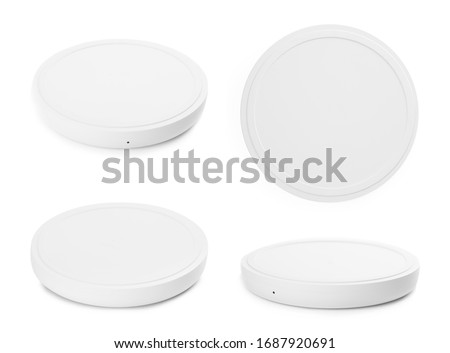 Collage with wireless chargers on white background Royalty-Free Stock Photo #1687920691