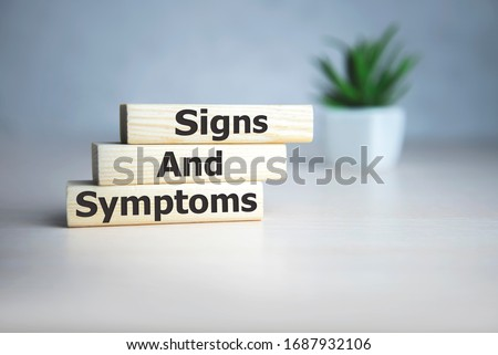 text Signs and SYMPTOMS on wooden cubes, medical concept. Royalty-Free Stock Photo #1687932106