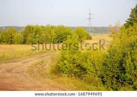 Morning summer photo of a country road, cloudy sky, light fog, Europe, the middle lane #1687949695