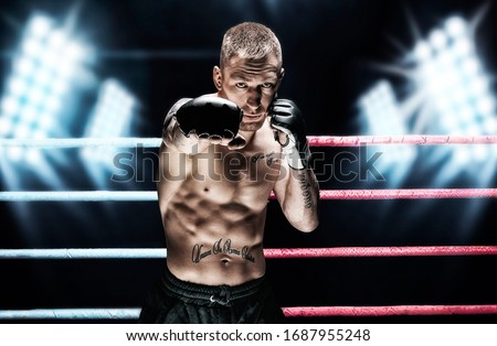 Mixed martial artist posing in the ring against spotlights. Concept of mma, ufc, thai boxing, classic boxing. Mixed media #1687955248