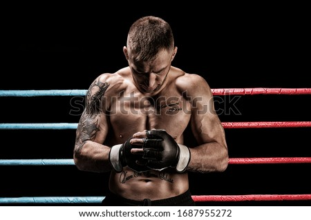 Mixed martial artist posing in boxing ring. Concept of mma, ufc, thai boxing, classic boxing. Mixed media #1687955272