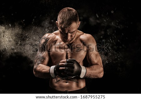 Mixed martial artist posing on a black background. Concept of mma, ufc, thai boxing, classic boxing. Mixed media Royalty-Free Stock Photo #1687955275