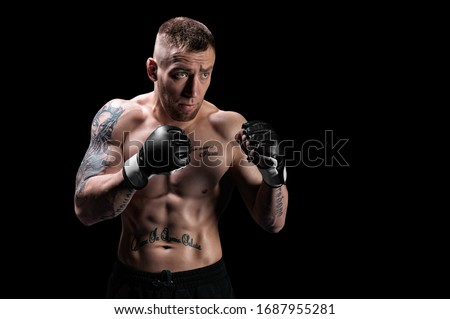 Mixed martial artist posing on a black background. Concept of mma, ufc, thai boxing, classic boxing. Mixed media #1687955281