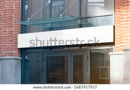 Blank white rectangular box store entrance mockup, glass brick wall. Empty exterior billboard for clinic or bank advertising mock up. Clear shop or restaurant cityboard mokcup template.
