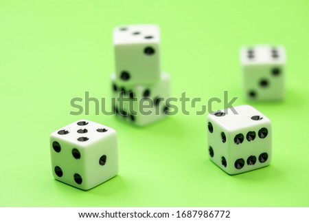 A conceptual photo of different numbered dice showing. #1687986772
