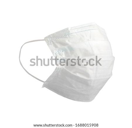 White medical mask. Medical protective masks isolated on white background. Healthcare and medical concept. Protective face mask or medical mask. Protective shielding bandage #1688015908