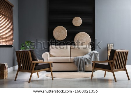 Stylish living room interior with comfortable sofa and armchairs #1688021356