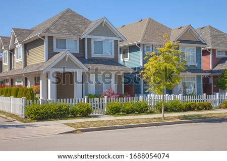 Residential homes architectural design & garden in Richmond BC Canada. Royalty-Free Stock Photo #1688054074
