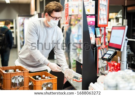 Protection against infection with the corona virus for cashiers in the supermarket #1688063272