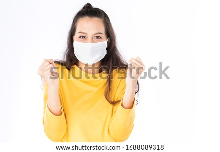 Young happy Asian woman wearing hygienic mask to prevent infection corona virus Air pollution pm2.5 she wearing a yellow sweater shoot in shot isolated on white background #1688089318