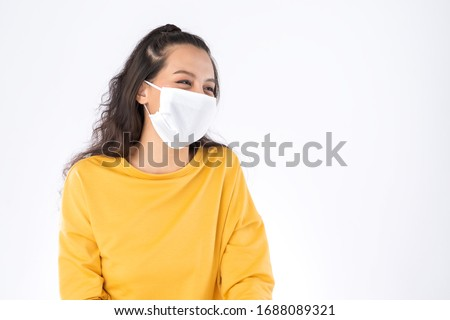 Young happy Asian woman wearing hygienic mask to prevent infection corona virus Air pollution pm2.5 she wearing a yellow sweater shoot in shot isolated on white background #1688089321