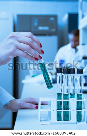 Scientist hand holding a Test tube, Laboratory research. #1688095402