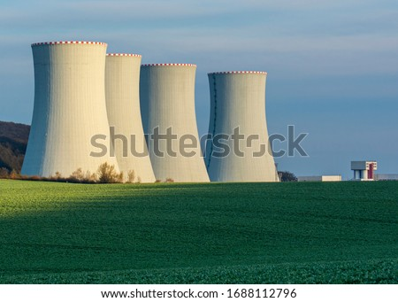 Nuclear Power Plant with the Blue Sky in The Background Royalty-Free Stock Photo #1688112796