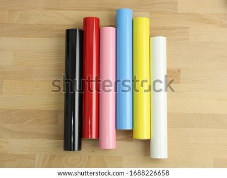 color heat transfer vinyl rolls over wood table