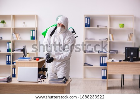 Contractor disinfecting office for COVID-19 coronavirus #1688233522