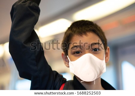 Little boy wear mask protect from virus buying electric ticket and walking in the public sky train station   #1688252503