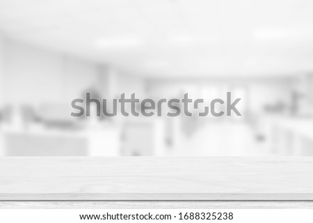 Empty white table top, counter over blur white bokeh light background. Empty wood shelf for product display, banner or mockup. #1688325238