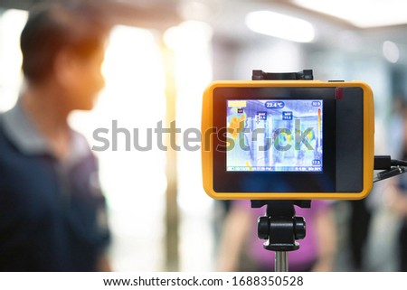 Asian people waiting for body temperature check before access to building for against epidemic flu covid19 or corona virus from wuhan in office by thermoscan or infrared thermal camera #1688350528