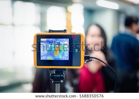 Asian people waiting for body temperature check before access to building for against epidemic flu covid19 or corona virus from wuhan in office by thermoscan or infrared thermal camera #1688350576