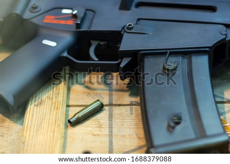 Cartridges Pistol. The gun is next to the cartridges. Weapon Suitcase for the gun. Buying weapons. Cartridges of different calibers next to the gun. Weapons storage. Collectible #1688379088