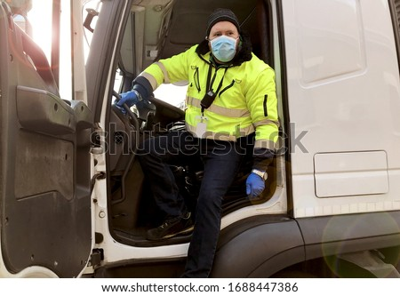 young transporter on the truck with face mask and protective gloves for Coronavirus #1688447386