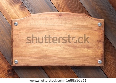 nameplate or wall sign at  wooden background texture surface with screws