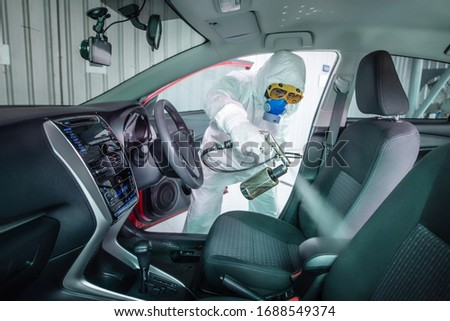 Clean surfaces in car with a disinfectant spray. Help kill coronavirus in  car after going out. #1688549374
