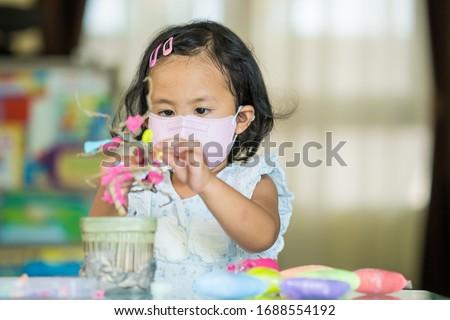 Cute asian girl playing at kindergarten. #1688554192