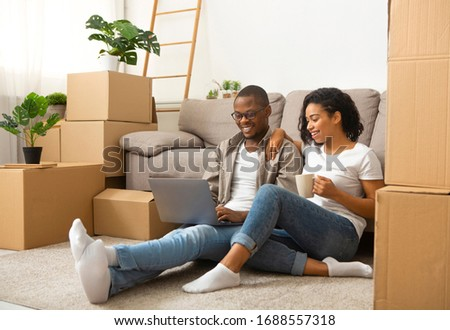Glad african american couple thinking about designer project of home #1688557318