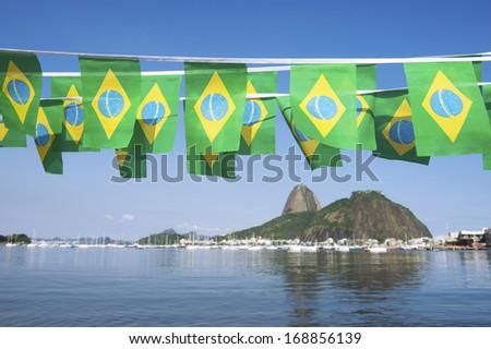 Brazilian flags bunting decoration above Sugarloaf Pao de Acucar Mountain Rio de Janeiro scenic sea view Brazil #168856139