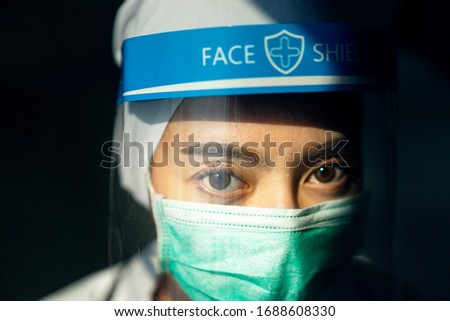 Closeup Asian female Doctor wearing face shield and PPE suit for Coronavirus outbreak or Covid-19, Concept of Covid-19 quarantine #1688608330