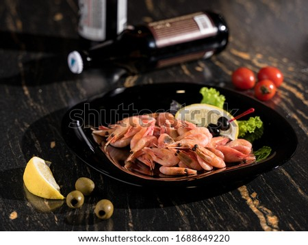 boiled shrimps, large shrimps, king prawns, black plate shrimps, lemon shrimps, restaurant serving, bar serving, shrimp appetizer #1688649220