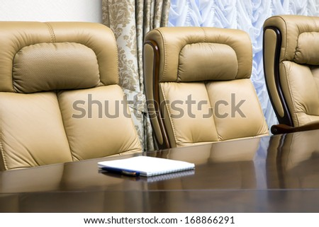 conference room with wooden table and beige leather armchairs #168866291