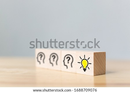 Concept creative idea and innovation. Wooden cube block with head human symbol and light bulb icon #1688709076